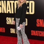 "Kate Hudson wore a custom Michel Kors outfit at the premiere of her mom's film ""Snatched"", featuring white and black printed pants match with a black blouse. (Photo: WENN)"