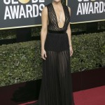 Hudson made a statement at the 2018 Golden Globes red carpet in a sheer, pleated, and plunging black Valentino dress, looking both ethereal and sexy. (Photo: WENN)