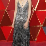 Gal Gadot delighted in her sparkling silver Givenchy gown featuring sequins from top to bottom along with dramatic layers of silver and gunmetal fringe. (Photo: WENN)