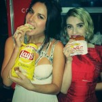 According to Olivia Munn and Emma Roberts, In-N-Out burgers and Lay's chips is what the Oscar parties are really all about. (Photo: Twitter)