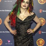 "Helena went all out in red green and yellow dreads and matching makeup to host ""A Night of Reggae"" for Save the Children UK. (Photo: WENN)"