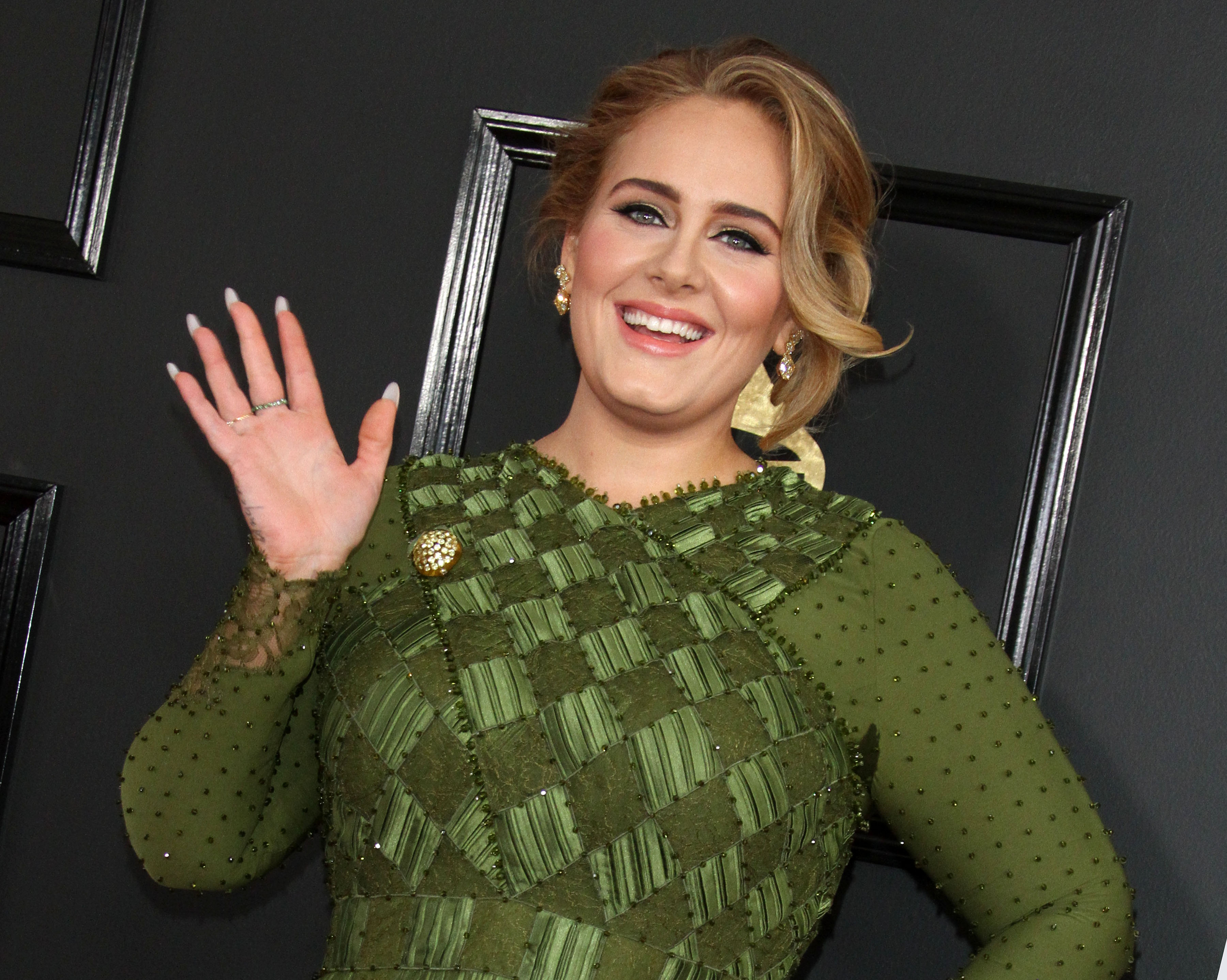 Adele's red-carpet appearances are rare and unexpected, but nonetheless stunning. Click through to see her top 10 style moment. (Photo: WENN)