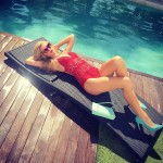 Paris Hilton dressed up her sexy red one-piece swimsuit with a pair of contrastive blue pumps. (Photo: Instagram)