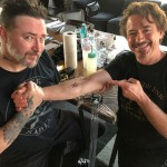 Robert Downey Jr. posted a series of pictures of the moment they got the group tat. (Photo: Instagram)