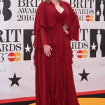 Adele proved red is her color in a cleavage-heavy, ruffled crimson gown, custom-made by Giambattista Valli at the 2016 Brit Awards. (Photo: WENN)