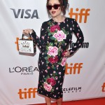 "Bonham Carte looked every inch the English rose in a quirky floral dress paired with a Queen clutch and red sunnies at the premiere of her movie ""55 Steps"". (Photo: WENN)"
