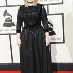 Adele arrived at the 2016 Grammy Awards red carpet rocking a gorgeous glittering gown by Givenchy that nipped the singer in at the waist, showing off her slimmed figure. (Photo: WENN)