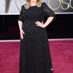 Adele sparkled in a black beaded Jenny Packham black gown at the 85th Academy Awards red carpet. (Photo: WENN)