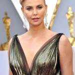 "Charlize Theron has said being beautiful is a curse. But being 5""10', with blonde hair, sharp cheekbones, and lithe limbs, it's hard, really, to feel sorry for her! (Photo: WENN)"