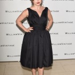 Helena swooped her kooky outfits for all out glamour as she attended the Williams Vintage Summer Party in a chick 1958's black dress. (Photo: WENN)
