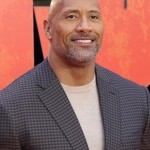 Dwayne Johnson's perfect smile and honey smooth voice are guaranteed to light up your day and make you smile too. (Photo: WENN)