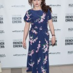 "Helena Bonham Carter kept it simple with a midi-length blue dress with pink floral print and gray lace-up combat boots at the screening of ""The Young and Prodigious T.S. Spivet."" (Photo: WENN)"