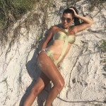 Kourtney Kardashian looked like a beachy goddess in this sexy gold bathing suit. (Photo: Instagram)