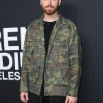 Sam arrived at the Saint Laurent Los Angeles Fashion Show rocking a laid-back look which consisted of a camouflage blazer and black jeans. (Photo: WENN)