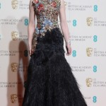 The actress shined in a custom embellished Alexander McQueen gown with a feathered black skirt as she walked down the red carpet of the 2016 BAFTA Awards. (Photo: WENN)