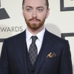 Sam Smith easily pulled off a three-piece tailored navy suit with patterned tie and contrasting pocket square at the 2016 Grammy Awards. (Photo: WENN)