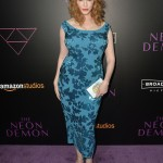 "Hendricks burst with femininity showcasing her curves in a figure-hugging teal, sequined dress at the premiere of Amazon's ""The Neon Demon."" (Photo: WENN)"