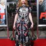 "Christina Hendricks celebrated the premiere of her movie ""Fist Fight"" in a multicolor dress that highlighted her cleavage under a sheer paneled keyhole around the bust. (Photo: WENN)"
