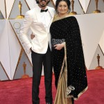 Dev Patel walking down the red carpet of the 89th Annual Academy Awards alongside her mom Anita Patel. (Photo: WENN)