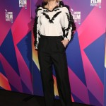 Cate Blanchet stepped out at the BFI London Film Festival looking chic in black high-waisted trousers paired with a white top with ruffle detailing by Givenchy. (Photo: WENN)