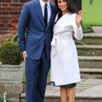 Meghan Markle celebrated the news of her engagement wearing a green crepe crew-neck dress underneath a bridal white belted coat. (Photo: WENN)