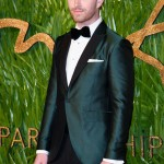Sam Smith was one of the best men at the 2017 British Fashion Awards in a deep green metallic tuxedo. (Photo: WENN)
