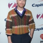 The singer opted for a vintage dad look at the red carpet of Z100's Jingle Ball wearing a knitted V-neck mustard sweater on top of a purplish buttoned up shirt, and trousers. (Photo: WENN)
