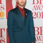 Smith looked so sharp while hitting the carpet at the 2018 BRIT awards in a deep fire engine red shirt with buttoned up pointed collar and blue suit. (Photo: WENN)