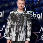 Sam kept things chill with this black, black and white washed out shirt and plaid trousers combo at the Global Awards 2018. (Photo: WENN)