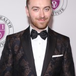 "Sam Smith looked dapper in a printed suit jacket a black bow tie at the 2018 ""Raise Your Voice"" CONCERT. (Photo: WENN)"