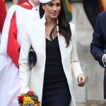 Markle stunned in a cream-colored coat and navy dress by Amanda Wakeley, coordinated with navy heels and navy bag at the Commonwealth Day services. (Photo: WENN)