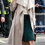 Meghan Markle wore a chic vibrant green skirt paired with a dusty pink coat and burnt orange stilettos for her first official visit to Northern Ireland. (Photo: WENN)