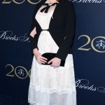 Christina Hendricks stunned as she arrived at the Brooks Brothers Bicentennial Celebration wearing a vintage-inspired dress with a black jacket featuring cut out on the sleeves. (Photo: WENN)