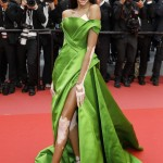 Winnie Harlow led the red carpet at the Fashion for Relief charity gala flashing her lithe legs ins a black strapless, parrot motif gown by Roberto Cavalli Couture. (Photo: WENN)