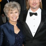 Brad Pitt and his mother Jane Etta smiling as they walked down the red carpet of the 2012 Academy Awards ceremony. (Photo: WENN)