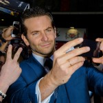 "Ever-handsome Bradley Cooper took a second to pose with his ""Hangover"" fans at the European premiere of the franchise's third movie. (Photo: WENN)"