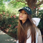 Grande keeping things casual with a black cap and long, perfectly straightened hair. (Photo: Instagram)