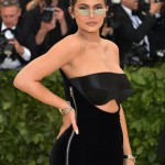 Kylie Jenner made a red carpet return at the Met Gala 2018 wearing a pair of opaque platinum sunglasses. (Photo: WENN)