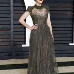 Dennings went for an ultra-feminine look with this lovely high-neck hunter green lace dress at the Vanity Fair Oscar Party 2015. (Photo: WENN)