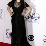 The actress made a statement in a goth-inspired black high-low gown with a lace bodice and bow-tie waist at the red carpet of the 2015 People's Choice Awards. (Photo: WENN)