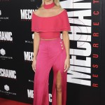 "Rosie Huntington-Whiteley stunned at the premiere of ""Mechanic Resurrection"" wearing a fiery pink wrap split pants and off-the shoulder crop top by Balmain. (Photo: WENN)"