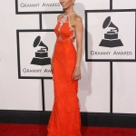 Giuliana Rancic wore a gorgeous orange lace halter-style neckline mermaid dress by Alex Perry at the 2014 Grammys red carpet. (Photo: WENN)
