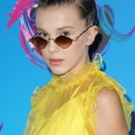 Millie Bobby Brown was the coolest teen at the 2017 Teen Choice Awards wearing a pair of small, vintage-looking sunglasses to complete her yellow look. (Photo: WENN)