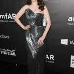 "The ""2 Broke Girls"" star attended the amfAR LA Inspiration Gala wearing an asymmetric strapless smoked silver gown. (Photo: WENN)"