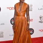 Lupita Nyongo'o looked stunning in a burnt orange, tight waist, plunging orange dress by Gucci at the 45th NAACP Image Awards. (Photo: WENN)