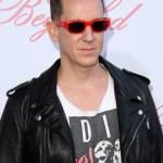 "The always eccentric Jeremy Scott added a pair of tiny yet bold red sunglasses to his outfit at the premiere of ""The Beguiled."" (Photo: WENN)"