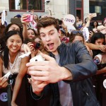 Shawn Mendes taking a selfie, pleasing a crowd of fans at the Much Music Video Awards. (Photo: WENN)