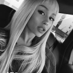Ariana looking chic with short wispy bangs and long blonde hair. (Photo: Instagram)
