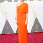 Olivia Munn stunned at the Oscars 2016 red carpet in a bright tangerine one-shoulder chiffon mermaid Stella McCartney dress. (Photo: WENN)