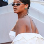 "Rihanna completed her Dior ensemble with a pair of white Andy Wolf sunglasses at the Cannes ""Okja"" premiere in Cannes. (Photo: WENN)"